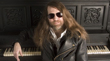 "FILE - In this Oct. 20, 2006, file photo, Paul O'Neill of Trans-Siberian Orchestra, poses in New York. O'Neill, who founded the progressive metal band, has died. University of South Florida police spokeswoman Renna Reddick told The Associated Press that O'Neill was found dead in his room by hotel staff at a Tampa Embassy Suites late Wednesday, April 5, 2017. The band said in a statement that O'Neill died from a ""chronic illness."" (AP Photo/Jim Cooper, File)"