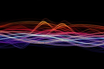an abstract background image featuring colourful waves of light